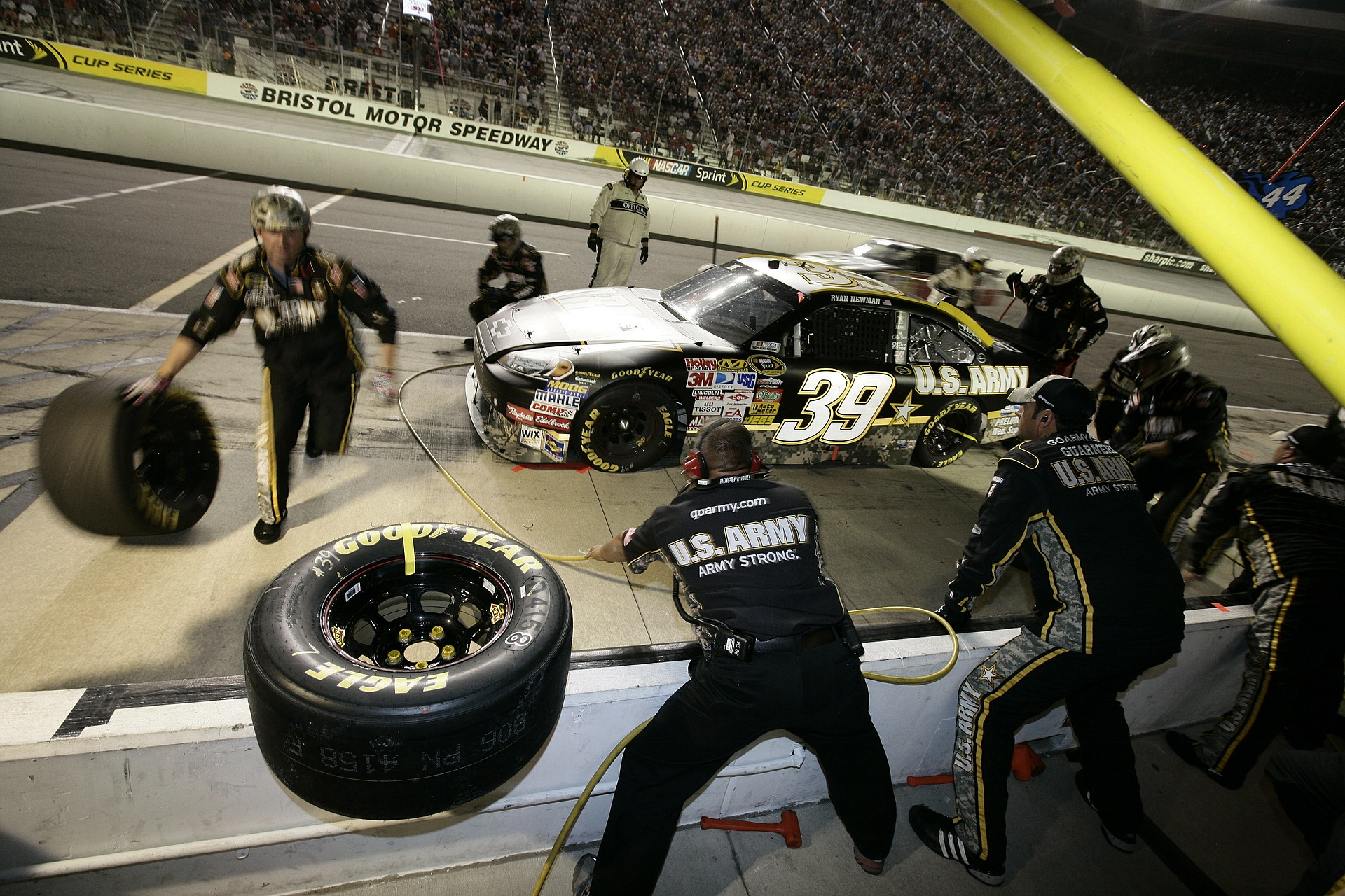Drivers may double their duties by helping out as a pit crew member.