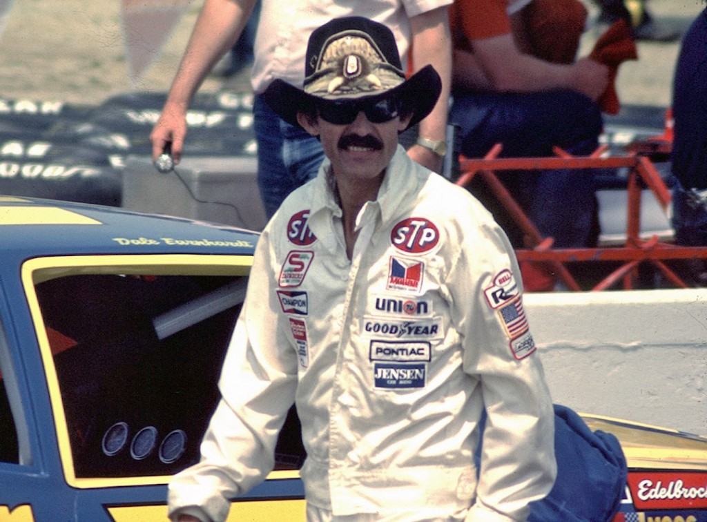 """The King"" of NASCAR, Richard Petty, struts around the track in his iconic cowboy hat in this picture from 1984. Though now retired, he's still very involved in the sport he loves."